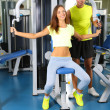 Guy and girl at gym — Stock Photo #30470225