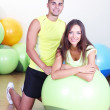 Guy and girl at gym — Stock Photo