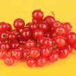 Stock Photo: Redcurrants on yellow background