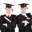 Two happy graduating students isolated on white — Stock Photo #30518517