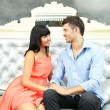 Beautiful young romantic couple sitting on sofa — 图库照片