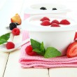 Delicious yogurt with fruit and berries on table close-up — Stock Photo