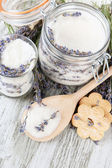 Jar of lavender sugar and fresh lavender flowers on wooden background — Stock Photo