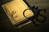 Antique keys and book on dark background — Stock Photo
