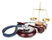 Medicine law concept. Gavel, scales and stethoscope isolated on white — Stock Photo