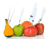 Injection into fruit and vegetables isolated on white — Stock Photo