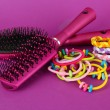Stock Photo: Scrunchies, hairbrush and hair - clip on pink background