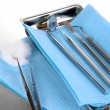 Dentist tools on grey table close-up — Stock Photo