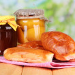 Fresh baked pasties with fruit jam, on wooden table, on bright background — Stock Photo