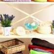 Beautiful white shelves with different home related objects, on color wall background — Stock Photo #30521061