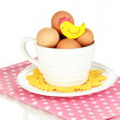 Stock Photo: Eggs in cup isolated on white