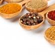 Assortment of spices in wooden spoons, isolated on white — Stock Photo #30521543