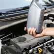 Stock Photo: Auto mechanic hand holding motor oil