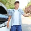 Man on road with car breakdown trying to stop car — Stock Photo #30522063