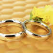 Wedding rings on bright background — Stock Photo
