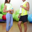 Girl and guy in fitness room — Stock Photo #30522335