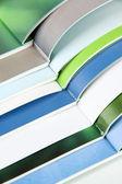 Many bright open magazines close-up — Stock Photo