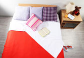 Bed in room close-up — Stock Photo