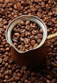 Metal turk on coffee beans background — Stock Photo