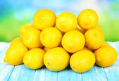 Ripe lemons on table on bright background — Stock Photo