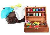 Sewing kit in wooden box and basket with cloth isolated on white — Stock Photo