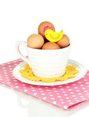 Eggs in cup isolated on white — Stock Photo