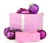 Gifts with christmas balls, isolated on white — Stockfoto