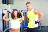 Girl and trainer engaged in simulator in gym — Foto de Stock