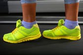 Women legs on treadmill in gum — Stock Photo
