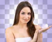 Bella ragazza con crema su sfondo bianco e viola piazze — Foto Stock