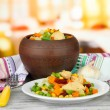 Baked mixed vegetable with chicken breast in pot, on bright background — Stock Photo
