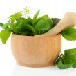 Fresh herbs in mortar, isolated on white — Stock Photo #30565399