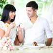 Beautiful young romantic couple at cafe — Stock Photo