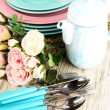 Lots beautiful dishes on wooden table close-up — Stock Photo #30565949