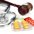Medicine law concept. Gavel, stethoscope and pills isolated on white — Stock Photo