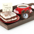 Stock Photo: Cup of tea with cakes on wooden tray isolated on white