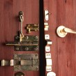 Metal bolts, latches and hooks in wooden open door close-up — Stockfoto