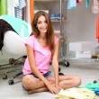Beautiful girl chooses clothes in walk-in closet — Stock Photo #30566095