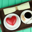 Wooden tray with breakfast, on color wooden background — Stock Photo