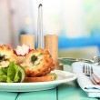 Chicken Kiev on croutons with mashed potatoes, on wooden table, on bright background — Stock Photo #30567641