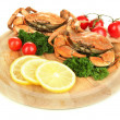 Stock Photo: Boiled crabs with lemon slices and tomatoes, on wooden board, isolated on white
