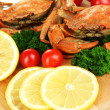 Stock Photo: Boiled crabs with lemon slices and tomatoes, on wooden board, close up