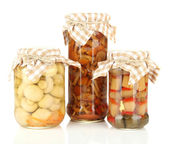 Delicious marinated mushrooms in glass jars, isolated on white — Stock Photo