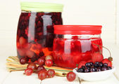 Home made berry jam on wooden table — Stock Photo