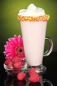 Delicious milk shake on dark yellow background — Stock Photo