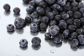 Blueberries on metal background — Stock Photo