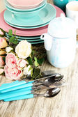 Lots beautiful dishes on wooden table close-up — Stock Photo