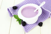 Delicious yogurt with berries on table close-up — Stock Photo