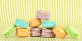 Gentle macaroons on green background — Stock Photo