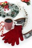 Figure skates with cup of coffee isolated on white — Stock Photo